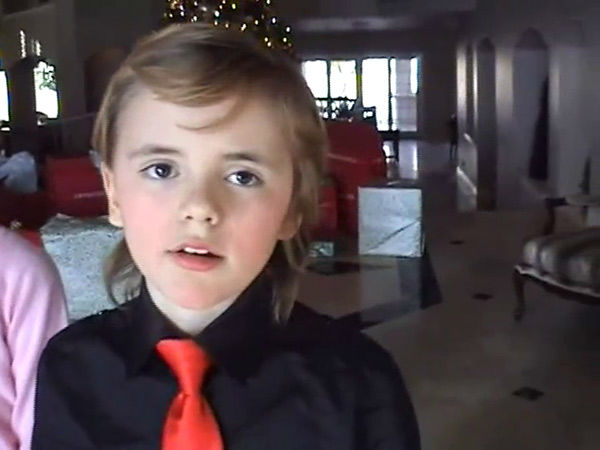 Michael Jackson&#39;s  eldest child, son Prince stands in front of a Christmas tree and presents in this scene from an undated home video. In the clip, the singer, who is behind the camera, asks him and his siblings, Paris and Blanket, what they want to do when they grow up. The video was played during his wrongful death trial in Los Angeles on June 26, 2013. His family is suing concert promoter AEG Live. <span class=meta>(OTRC &#47; Official trial exhibit - Los Angeles Superior Court)</span>