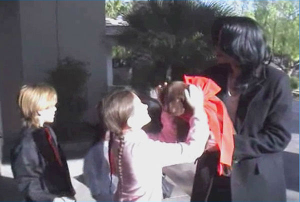Michael Jackson presents his children, Prince, Paris and Blanket, with a chocolate labrador puppy, Kenya, in this undated home video. The video was played during his wrongful death trial in Los Angeles on June 26, 2013. His family is suing concert promoter AEG Live. <span class=meta>(OTRC &#47; Official trial exhibit - Los Angeles Superior Court)</span>