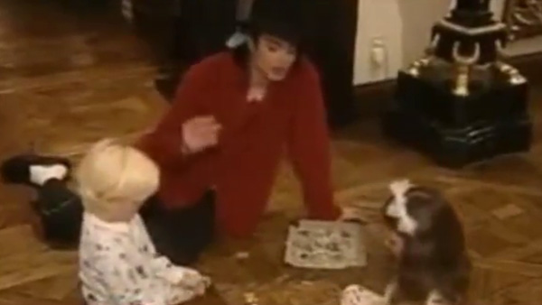 Michael Jackson plays with and sings to two of his children, Prince and Paris, in this undated home video.