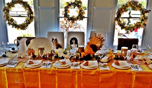 Julianne Hough, girlfriend of Ryan Seacrest, Tweeted this Instagram photo of their Thanksgiving table and their blenheim and tri-color Cavalier King Charles Spaniels, Lexi and Harley, on Thanksgiving Day - Nov. 22, 2012, adding: &#39;Mom....! What&#39;s taking you guys so long?&#39; <span class=meta>(instagram.com&#47;p&#47;SV1W85Cf3x&#47; twitter.com&#47;juliannehough&#47;status&#47;271675042092421121)</span>