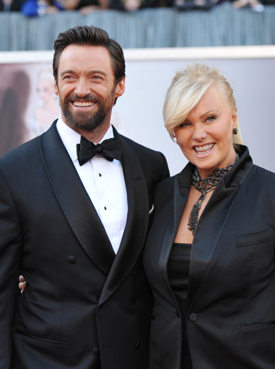 Actors Hugh Jackman, left, and Deborra-Lee Furness arrive at the Oscars at the Dolby Theatre on Sunday Feb. 24, 2013, in Los Angeles.