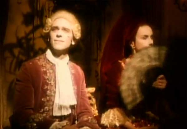 Hugh Laurie appears in Annie Lennox&#39;s music video &#39;Walking on Broken Glass,&#39; released in 1992. Laurie appears in the video as Prince George, and the setting is a highly unusual meeting of assembly nobles and notables. Laurie went on to star as the witty and sarastic doctor Gregory House in the television show &#39;House M.D.&#39; <span class=meta>(Arista &#47; Sony BMG Music Entertainment)</span>