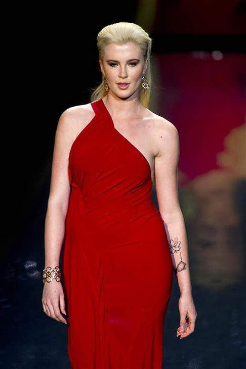 "<div class=""meta image-caption""><div class=""origin-logo origin-image ""><span></span></div><span class=""caption-text"">Ireland Baldwin, an 18-year-old model and daughter of actors Alec Baldwin and Kim Basinger, walks the runway at the Go Red For Women/The Heart Truth Red Dress 2014 Collection fashion show during Mercedes-Benz Fashion Week in New York on Feb. 6, 2014. She is wearing a design by Donna Karan. (Amanda Schwab / Startraksphoto.com)</span></div>"