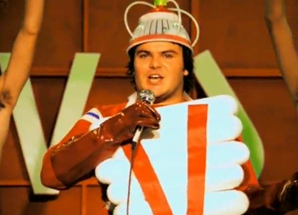 "<div class=""meta ""><span class=""caption-text "">Jack Black appears in Beck's music video 'Sexx Laws,' released in 1999. Black appears in the video as a member of the 'Vision Warrior Men's Circle,' and the video contains a number of outlandish scenes including a room full of football players and a spinning mannequin of a zebra with a banjo. Black went on to star in films such as 'The Holiday,' 'School of Rock' and 'Kung Fu Panda.' (Geffen Records)</span></div>"