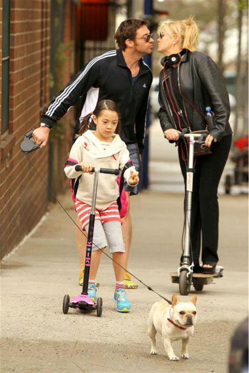 The time Hugh Jackman and wife Deborra-Lee Furness shared a tender moment while walking the family dog, Dali, with daughter Ava in New York on April 10, 2013. <span class=meta>(Freddie Baez &#47; Startraksphoto.com)</span>