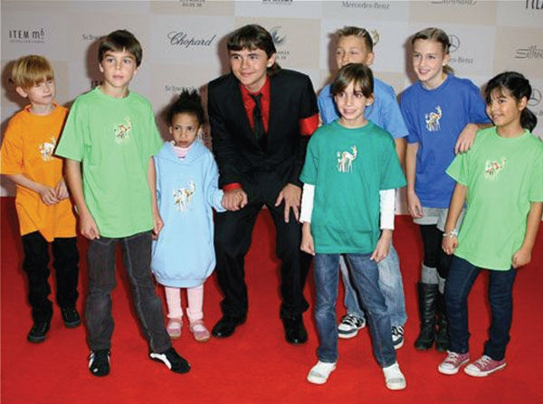Michael Jackson's eldest child, son Prince, is seen with a group of children in this undated undated photo, presented as evidence during the singer's wrongful death trial in Los Angeles on June 26, 2013. His family is suing concert promoter AEG Live.