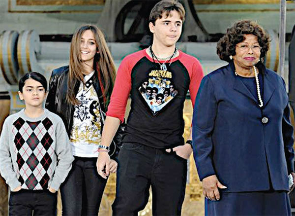 "<div class=""meta image-caption""><div class=""origin-logo origin-image ""><span></span></div><span class=""caption-text"">L-R: Michael Jackson's youngest son Blanket, daughter Paris, eldest son Prince and mother Katherine are seen in this undated photo, taken following his death in June 2009. The image was presented as evidence during the singer's wrongful death trial in Los Angeles on June 26, 2013. His family is suing concert promoter AEG Live. (OTRC / Official trial exhibit - Los Angeles Superior Court)</span></div>"