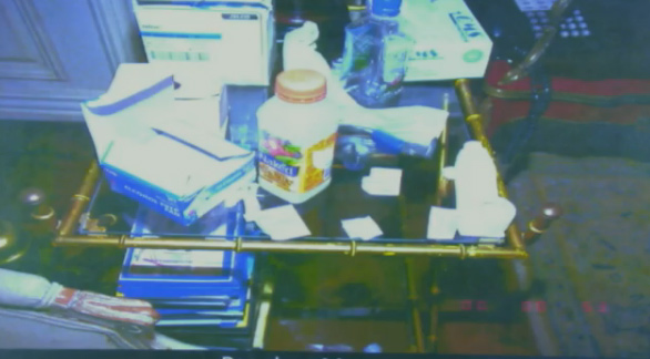 Oct. 5, 2011: During Conrad Murray&#39;s involuntary manslaughter trial, L.A. Coroner&#39;s Office investigator Elissa Fleak identified items she recovered from the bedroom where Michael Jackson was found lifeless. Pictured: A table in the room contains a bottle of Naked Juice, alcohol prep pads and IV catheters. <span class=meta>(OTRC)</span>