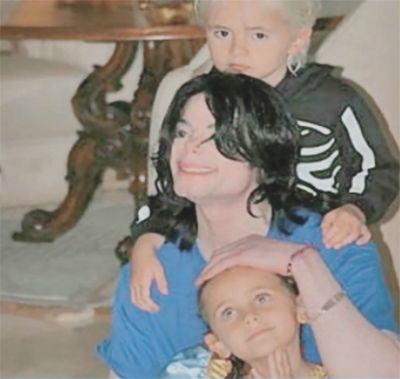 Michael Jackson is seen with son Prince and daughter Paris in this undated photo, presented as evidence during the singer's wrongful death trial in Los Angeles on June 26, 2013. His family is suing concert promoter AEG Live.