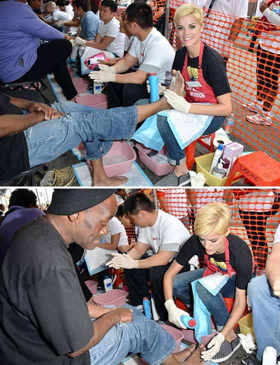 Jaimie Alexander, who plays Sif in the 'Thor' movies, powders a man's feet at the Los Angeles Mission's annual Easter event on April 18, 2014.