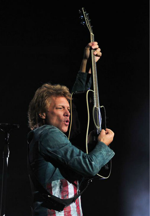 Jon Bon Jovi doesn&#39;t just sing -- he&#39;s a born performer. Turn up &#39;Livin&#39; On A Prayer&#39; at home and check out photos of the Bon Jovi frontman&#39;s most inspiring concert moves during the rock band&#39;s 2013 Because We Can world tour. Here is a shot of Jon Bon Jovi performing with Bon Jovi in Anaheim, California on Oct. 9, 2013. The band earned the No. 1 spot on Pollstar&#39;s list of top-grossing tours of 2013. <span class=meta>(Kelly A. Swift &#47; Startraksphoto.com)</span>