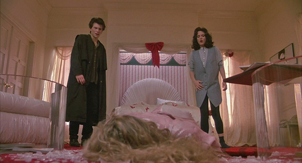 Winona Ryder &#40;Veronica Sawyer&#41; and Christian Slater &#40;J.D.&#41; as they stand over Kim Walker &#40;Heather Chandler&#41; in a scene from the 1988 movie &#39;Heathers.&#39; <span class=meta>(New World Pictures &#47; Anchor Bay Entertainment)</span>