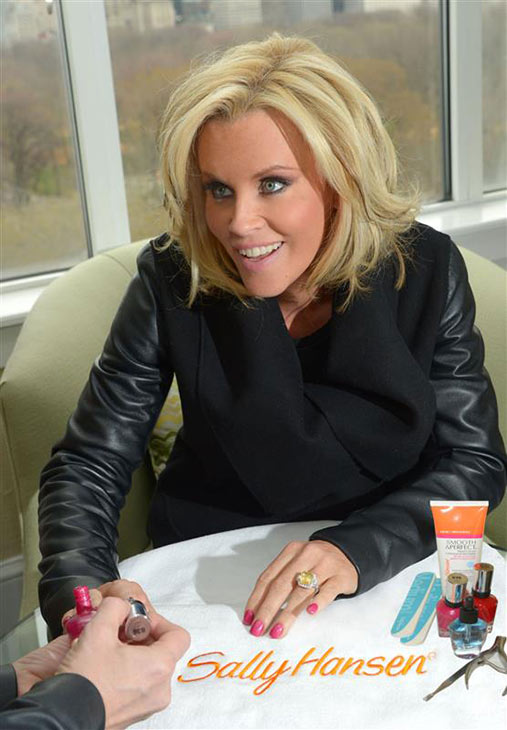 Jenny McCarthy shows off her yellow sapphire engagement ring on ABC&#39;s &#39;The View&#39; on April 16, 2014. McCarthy, a co-host on the show, announced her engagement to Donnie Wahlberg on the show that morning. <span class=meta>(ABC Photo &#47; Heidi Gutman)</span>