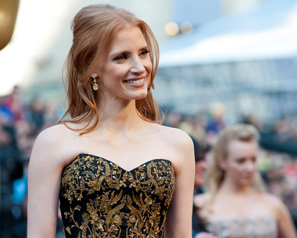Jessica Chastain arrives for the 84th Annual Academy Awards from Hollywood, Calif. on Feb. 26, 2012. The actress stunned in a black and gold Alexander McQueen gown which featured intricate vintage detailing. The actress wore her signature red locks down. The 2013 Oscar ceremony is scheduled to air February 24 on ABC.  <span class=meta>(A.M.P.A.S.)</span>