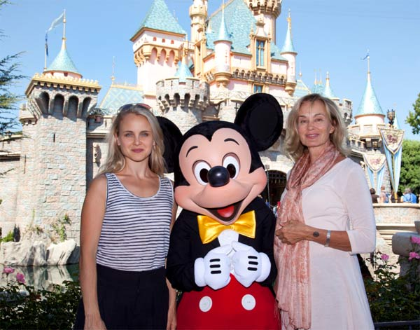 Jessica Lange and daughter Shura pose with Mickey Mouse outside Sleeping Beauty Castle at Disneyland in Anaheim, California, on Sept. 2, 2011.