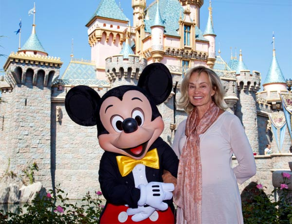 Jessica Lange poses with Mickey Mouse outside Sleeping Beauty Castle at Disneyland in Anaheim, California, on Sept. 2, 2011.