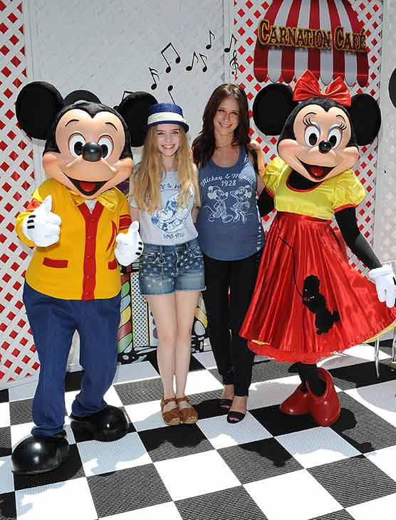 A pregnant Jennifer Love Hewitt poses with Darcy Rose Byrnes &#40;&#39;Young and the Restless,&#39; &#39;Desperate Housewives&#39; and &#39;Sofia the First&#39; actress&#41; and Mickey and Minnie Mouse at Old Navy&#39;s Mickey Through The Decades Collection Launch at the Walt Disney Company studio lot in Burbank, California. <span class=meta>(Michael Simon &#47; startraksphoto.com)</span>