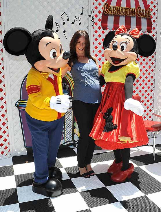 A pregnant Jennifer Love Hewitt poses with Mickey and Minnie Mouse at Old Navy&#39;s Mickey Through The Decades Collection Launch at the Walt Disney Company studio lot in Burbank, California. <span class=meta>(Michael Simon &#47; startraksphoto.com)</span>