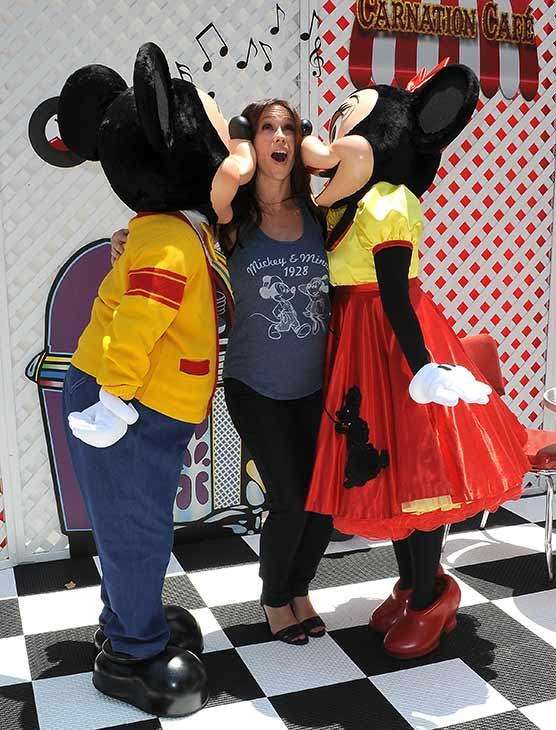 A pregnant Jennifer Love Hewitt receives kisses from Mickey and Minnie Mouse at Old Navy&#39;s Mickey Through The Decades Collection Launch at the Walt Disney Company studio lot in Burbank, California. <span class=meta>(Michael Simon &#47; startraksphoto.com)</span>