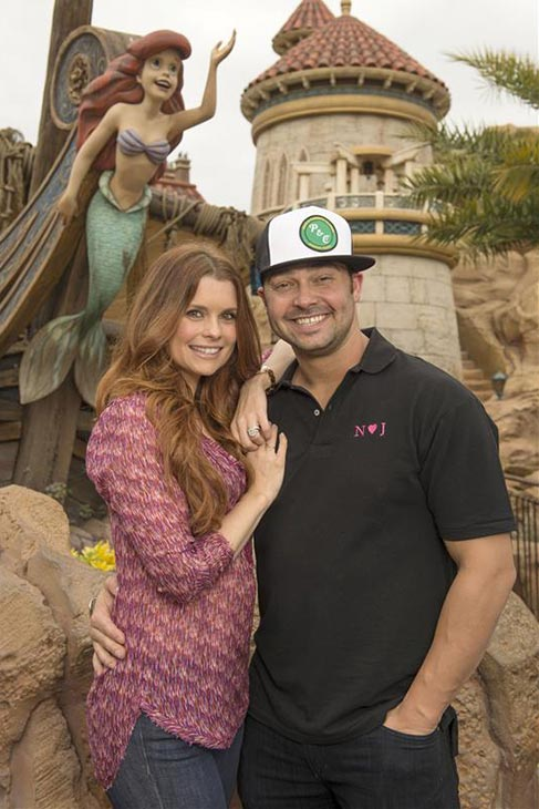 JoAnna Garcia Swisher, who portrays Ariel on the ABC series 'Once Upon A Time,' and husband and baseball player Nick Swisher pose in front of the 'Under the Sea - Journey of The Little Mermaid' attraction at Walt Disney World in Florida on Nov. 15, 2013.