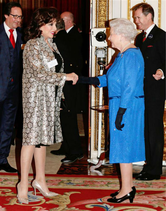 Joan Collins chats with Queen Elizabeth II at the Reception for the Dramatic Arts at Buckingham Palace on Feb. 17, 2014. <span class=meta>(Rex Features &#47; Startraksphoto.com)</span>
