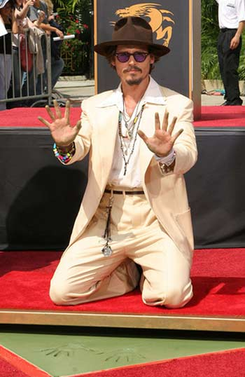 Johnny Depp appears at Graumann's Chinese Theater where he was honored with a handprint and footprint ceremony in September 2005.