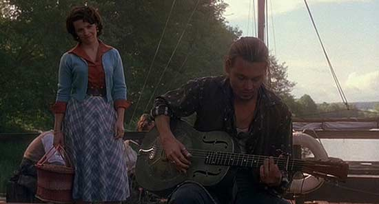 Johnny Depp appears in a scene from the 2000 film 'Chocolat' alongside his co-star Juliette Binoche.