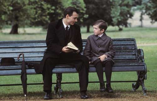 Actor Johnny Depp and Freddie Highmore appear in a scene from the 2004 film 'Finding Neverland,' where Depp depicts writer J.M. Barrie and his life's tribulations that inspired him to create the story 'Peter Pan.'