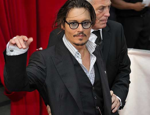 Johnny Depp appears at the premiere of the 2009 film 'Public Enemies' in Paris, France on July 2, 2009.