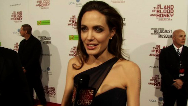 Angelina Jolie talks to OnTheRedCarpet.com at the Los Angeles premiere of her film 'In The Land of Blood and Honey' on Dec. 8, 2011.