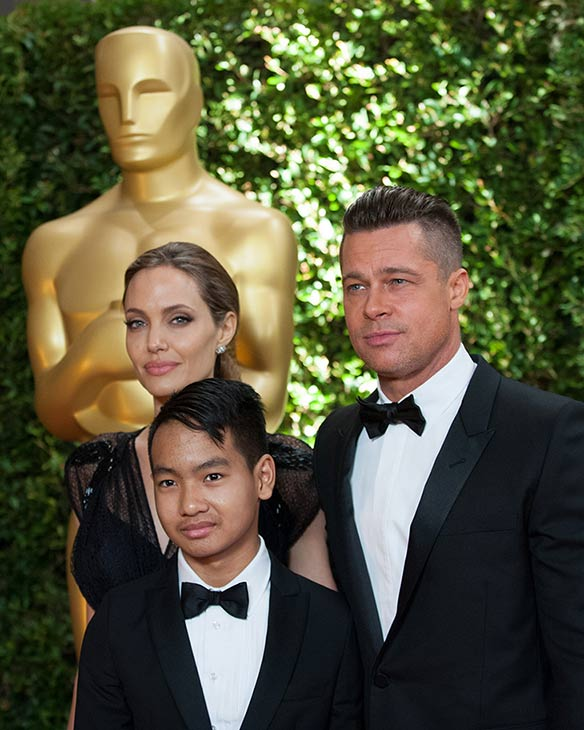 Jean Hersholt Humanitarian Award recipient Angelina Jolie appears with partner Brad Pitt and son Maddox at the 2013 Governors Awards at The Ray Dolby Ballroom at Hollywood and Highland Center in Hollywood, California on Saturday, Nov. 16, 2013.