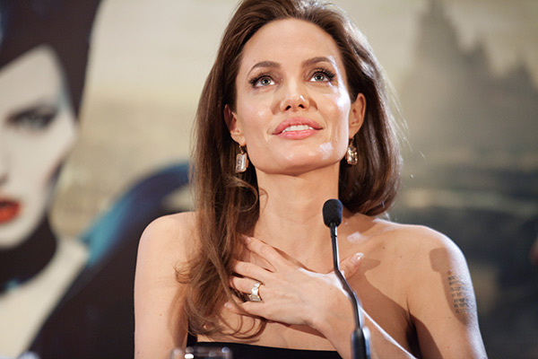 "<div class=""meta ""><span class=""caption-text "">Angelina Jolie appears at a photo call for the movie 'Maleficent' in Paris, France on May 6, 2014. (CB / Disney)</span></div>"