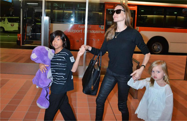 Angelina Jolie is seen at Tokyo International Airport on July 28, 2013 with two of her and Brad Pitt's six children -- Pax, 9, and Vivienne, 5.