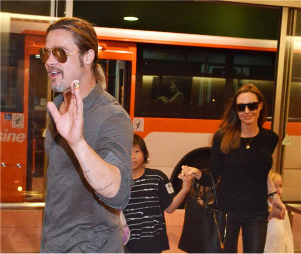 Angelina Jolie and Brad Pitt are seen at Tokyo International Airport on July 28, 2013 with two of their six children -- Pax, 9, and Vivienne, 5. <span class=meta>(Aflo &#47; startraksphoto.com)</span>