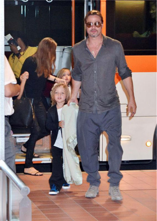 Angelina Jolie and Brad Pitt are seen at Tokyo International Airport on July 28, 2013 with two of their six children -- twins Knox and Vivienne, 5. <span class=meta>(Aflo &#47; startraksphoto.com)</span>
