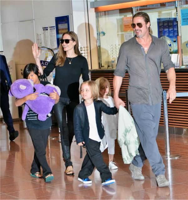 Angelina Jolie and Brad Pitt are seen at Tokyo International Airport on July 28, 2013 with three of their six children -- Pax, 9, and twins Knox and Vivienne, 5.