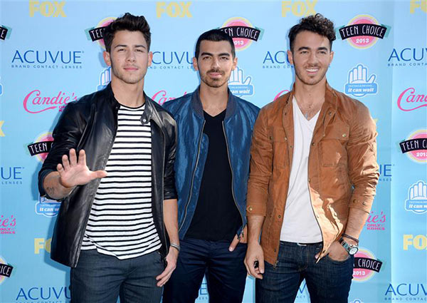 Nick Jonas, Joe Jonas and Kevin Jonas appear at the 2013 Teen Choice Awards in Universal City, California on Aug. 11, 2013. The brothers rose to fame with their group the Jonas Brothers and announced later that year  <span class=meta>(Lionel Hahn &#47; AbacaUSA &#47; Startraksphoto.com)</span>