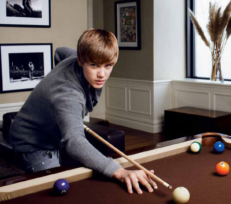 Justin Bieber plays pool in a photograph...