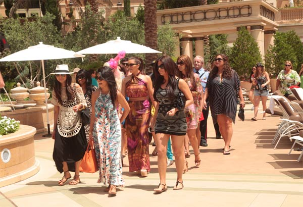 Kim Kardashian, her sisters Khloe and Kourtney, fiance Kris Humphries' sister Kaela and friends attend her bachelorette celebration at the Palazzo Pool in Las Vegas on Sunday, July 2