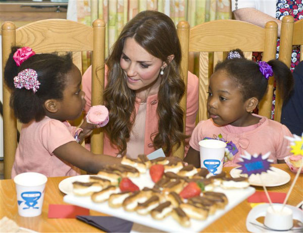 The time Kate Middleton shared a delicious snack of eclairs and strawberries with these two little girls during a visit to Naomi House Children&#39;s Hospice in Winchester in the UK on April 29, 2013. <span class=meta>(Barcroft Media &#47; Startraksphoto.com)</span>