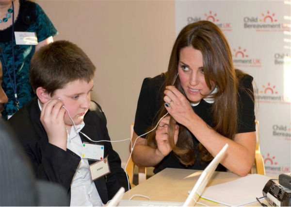 "<div class=""meta image-caption""><div class=""origin-logo origin-image ""><span></span></div><span class=""caption-text"">The time Kate Middleton shared earbuds to listen to some tunes with this boy at Child Bereavement Charity Center in Saunderton in the UK on March 19, 2013. (Barcroft Media / Startraksphoto.com)</span></div>"