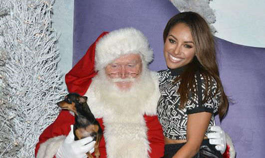 &#39;Vampire Diaries&#39; actress Kat Graham sits on Santa Claus&#39; knee and poses with her dog for a holiday pet portrait at the Beverly Center shopping mall in Beverly Hills, California on Nov. 14, 2013. <span class=meta>(Tony DiMaio &#47; Startraksphoto.com)</span>