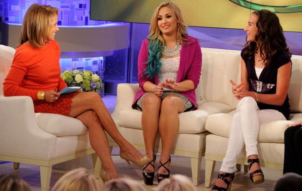 Katie Couric and Demi Lovato appear on an episode of Katie, which aired on Sept. 24, 2012. - Provided courtesy of Ida Mae Astute / ABC
