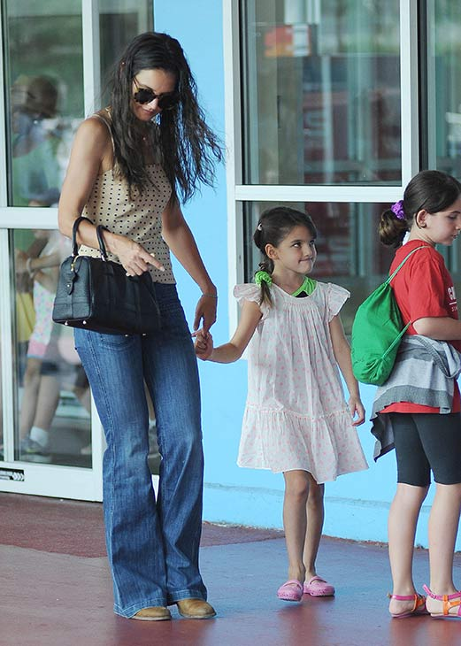 "<div class=""meta ""><span class=""caption-text "">Katie Holmes and her and Tom Cruise's daughter Suri Cruise, 7, are seen on a stroll through Chelsea Piers in New York City on July 15, 2013. (Humberto Carreno / startraksphoto.com)</span></div>"