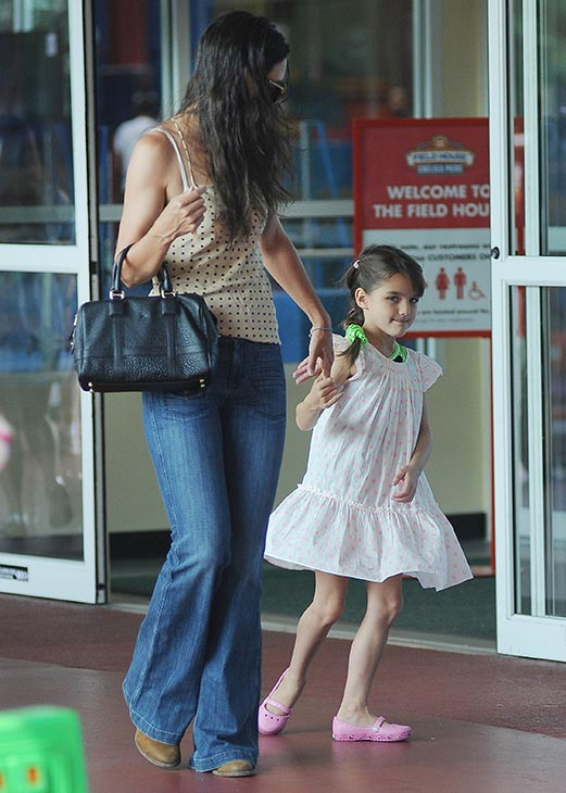 "<div class=""meta image-caption""><div class=""origin-logo origin-image ""><span></span></div><span class=""caption-text"">Katie Holmes and her and Tom Cruise's daughter Suri Cruise, 7, are seen on a stroll through Chelsea Piers in New York City on July 15, 2013. (Humberto Carreno / startraksphoto.com)</span></div>"