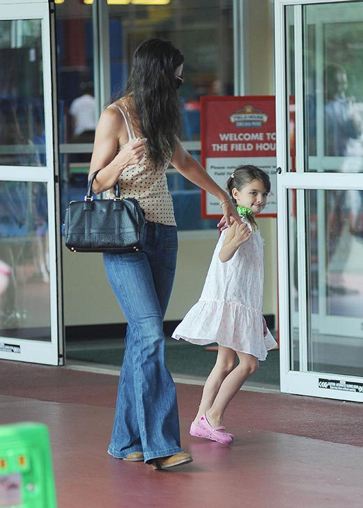 Katie Holmes and her and Tom Cruise's daughter Suri Cruise, 7, are seen on a stroll through Chelsea Piers in New York City on July 15, 2013.