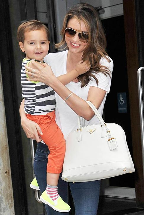 Miranda Kerr holds her and Orlando Bloom's son Flynn while walking in New York City on July 31, 2013.