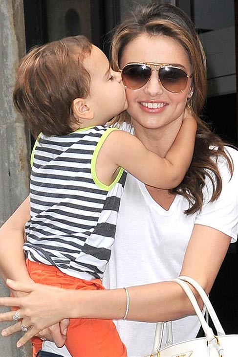 "<div class=""meta ""><span class=""caption-text "">Miranda Kerr gets a kiss from her and Orlando Bloom's son Flynn while walking in New York City on July 31, 2013. (Javier Mateo / startraksphoto.com)</span></div>"