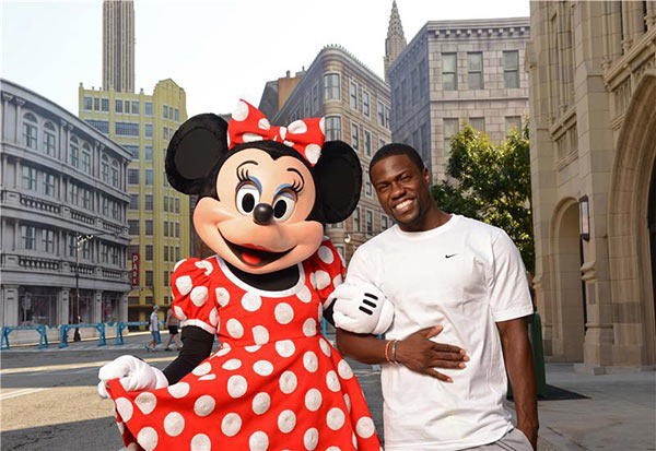 Kevin Hart poses with Minnie Mouse on the New York street set at Disney's Hollywood Studios at the Walt Disney World Resort in Lake Buena Vista, Florida on July 12, 2013.