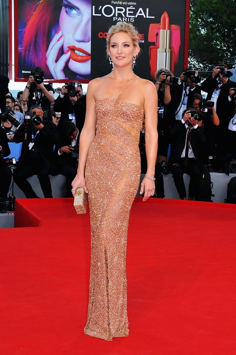 Kate Hudson, wearing an Atelier Versace gown and...